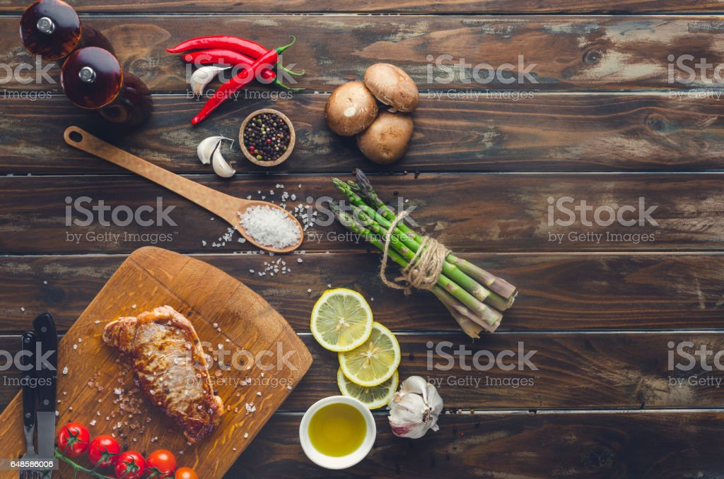 Cooked steak on a cutting board. stock photo
