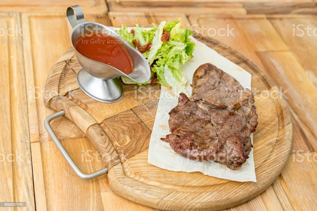 cooked steak on a pita stock photo