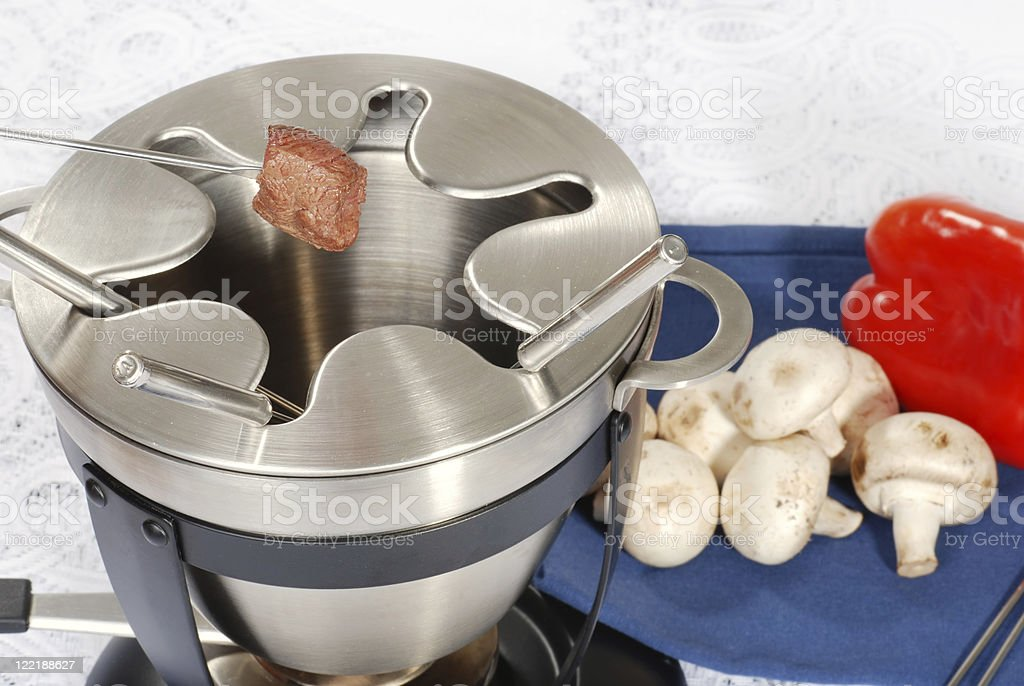 cooked steak on fondue fork royalty-free stock photo