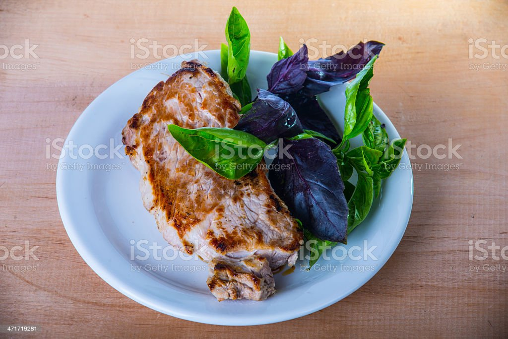 Cooked steak on wooden backgroung royalty-free stock photo