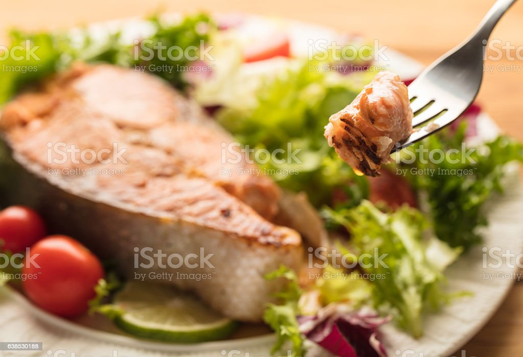 cooked steak red fish stock photo