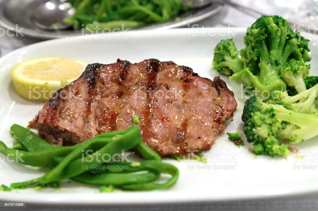 cooked tuna fish with vegetables grilled stock photo