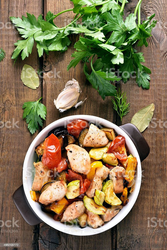 Cooked vegetables with chicken fillet stock photo