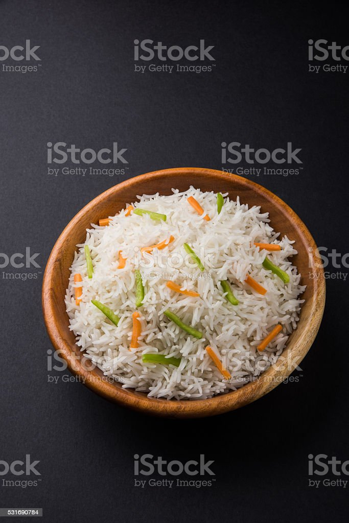 cooked white basmati rice with carrot and capsicum toppings stock photo