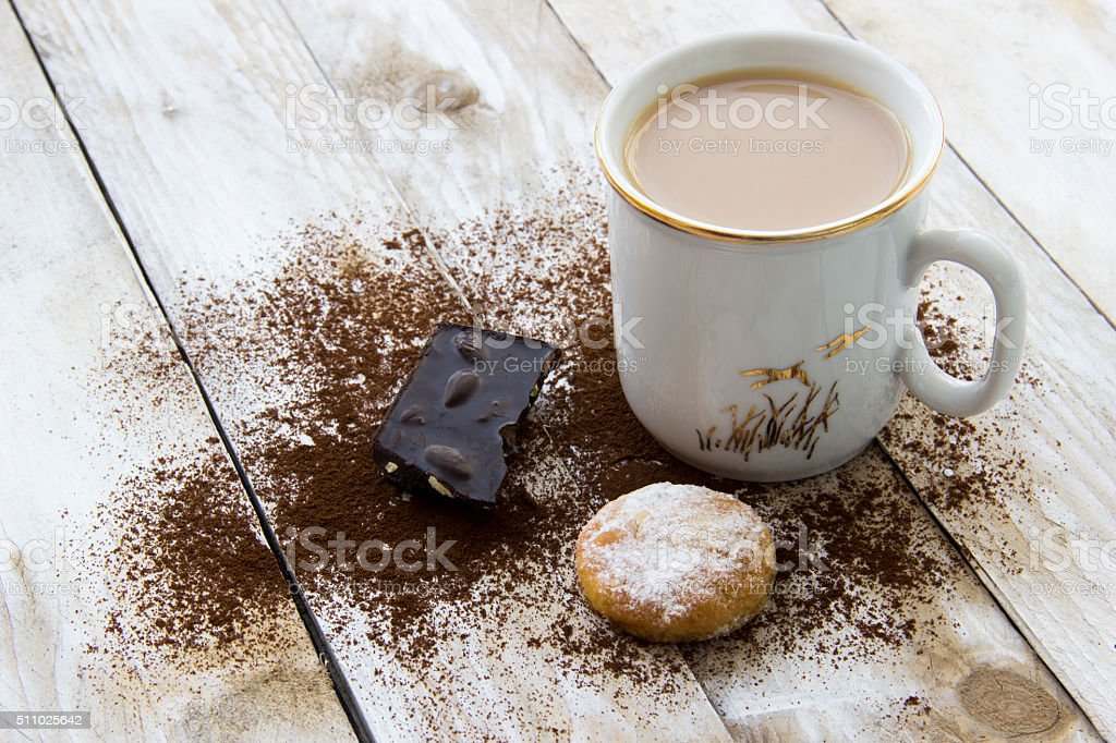 Cookie, cocoa and cup of coffee on wooden table stock photo