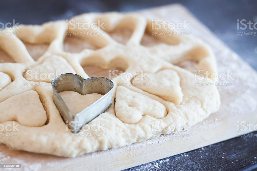 cookie cutters as heart and cut out cookie dough stock photo