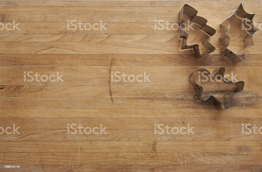 Cookie Cutters on a Worn Cutting Board royalty-free stock photo