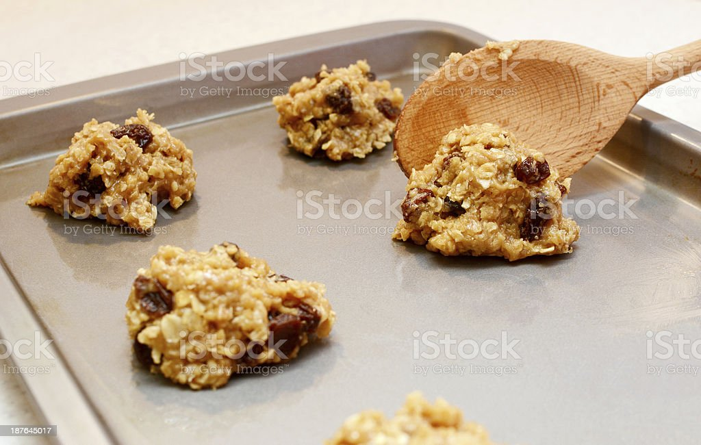Cookie dough being spooned onto baking sheet stock photo