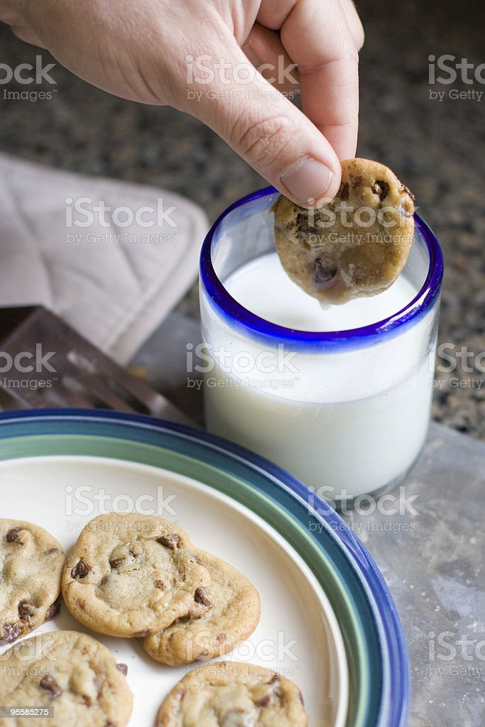 Cookie dripping with milk royalty-free stock photo