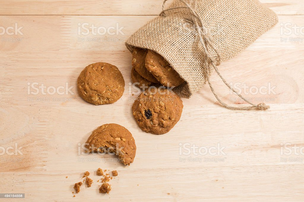 Cookie in woven sack on wood stock photo
