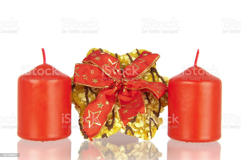 Cookie knotted ribbon and candles stock photo