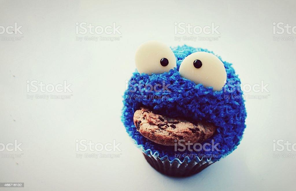Cookie monster cupcake stock photo