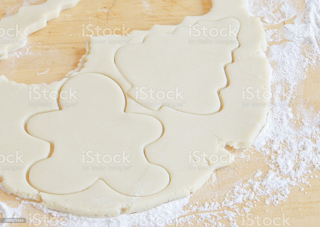 Cookie shapes cut from dough royalty-free stock photo