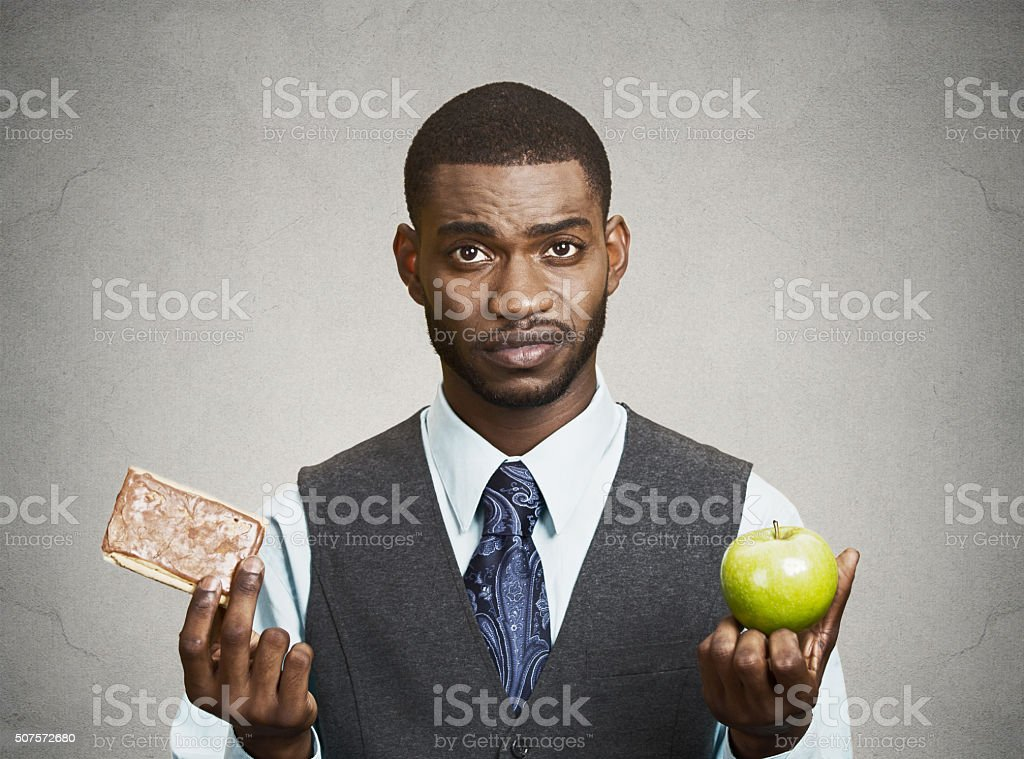 Cookie versus apple, healthy diet choices stock photo