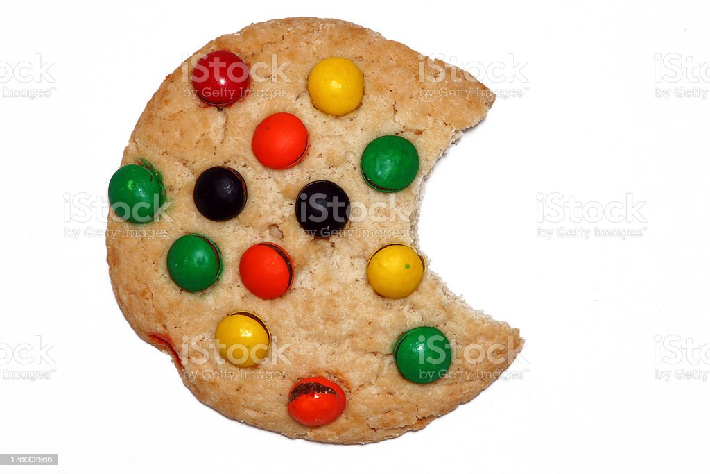 Cookie with Candy Chips and a big bite stock photo