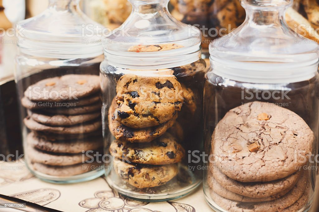 Cookies and biscuits in glass jars on bar for sale stock photo