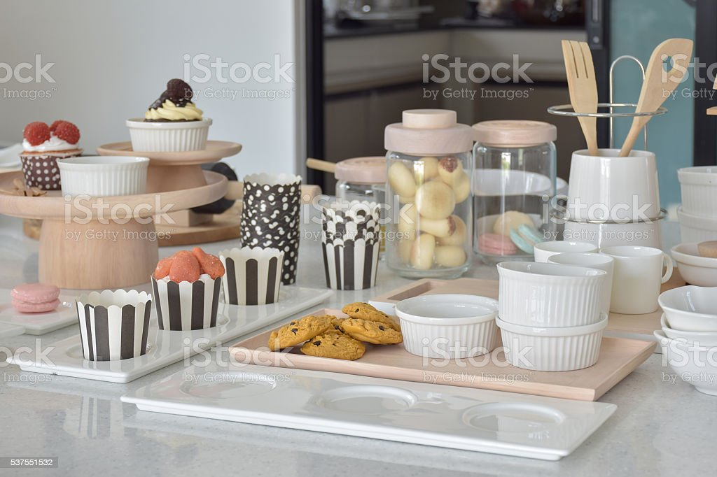Cookies and cupcakes with cute bakeware setting on table stock photo