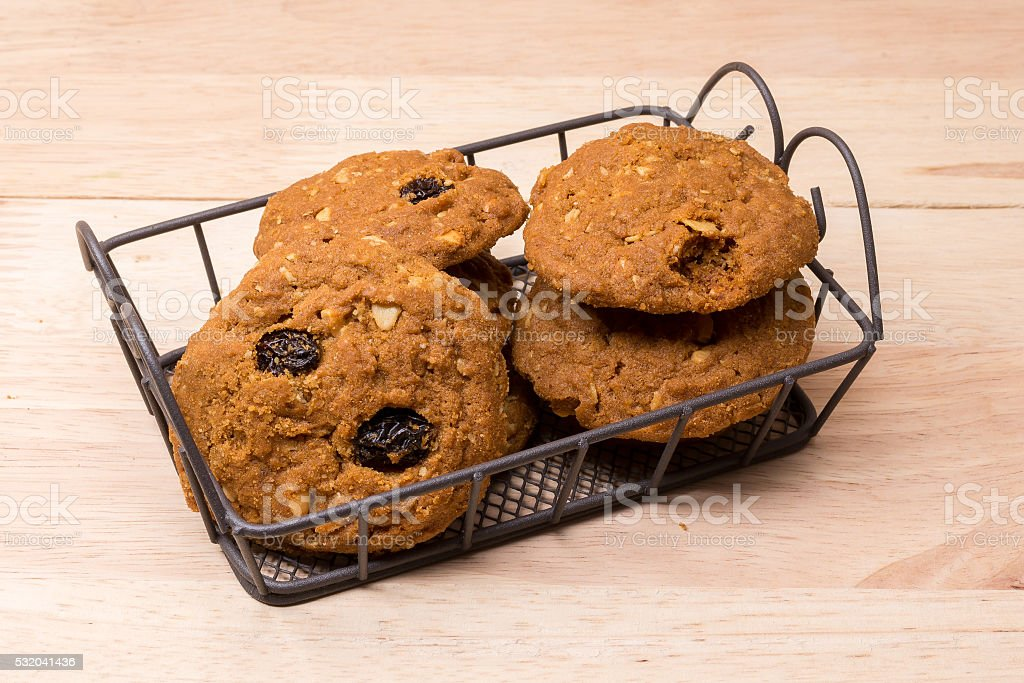 cookies and glass of milk on wooden background (selective focus stock photo