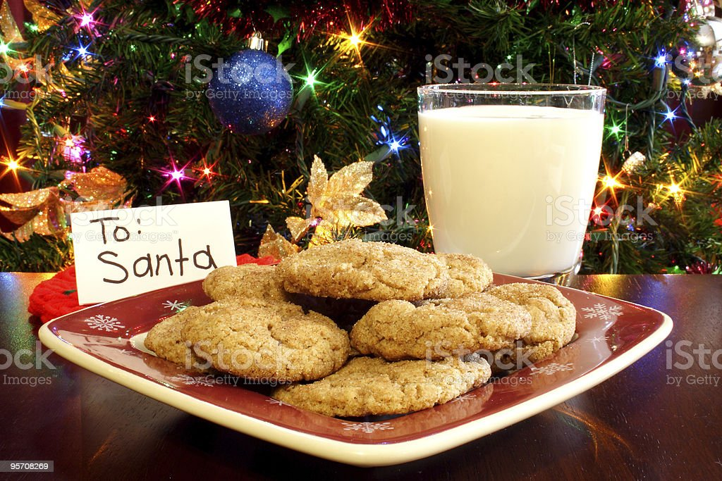 Cookies and milk left for Santa at Christmas time stock photo