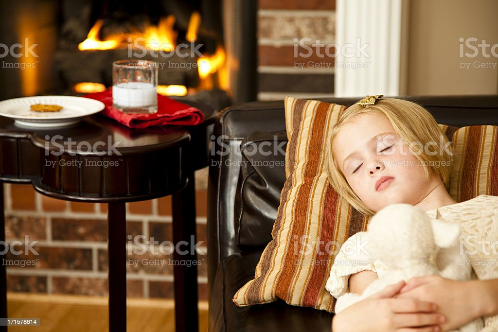 Cookies and milk sampled by Santa near sleeping child royalty-free stock photo