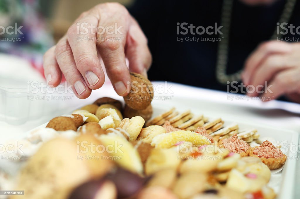 Cookies and tea, grandmother eating homemade buiscuits stock photo