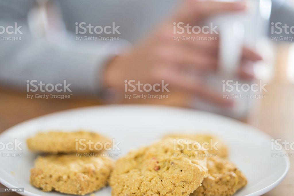Cookies and woman holding a cup royalty-free stock photo