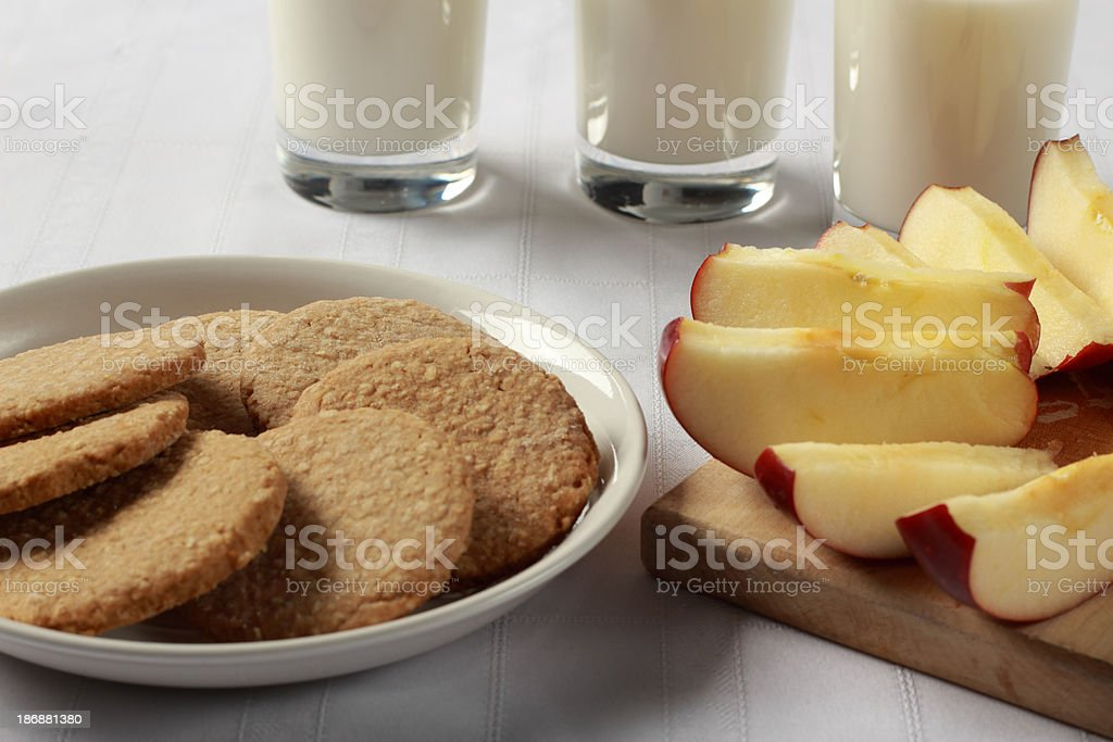 Cookies, apples and milk closeup royalty-free stock photo
