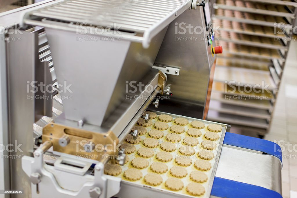 Cookies being made in a factory stock photo