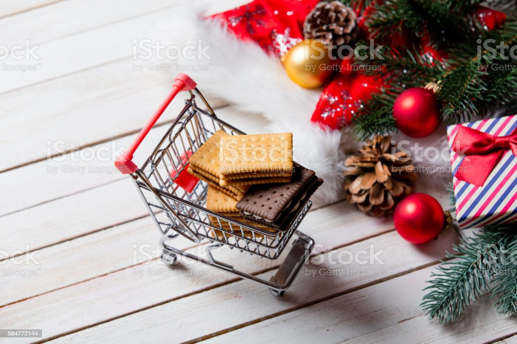 cookies, cart and christmas decorations stock photo
