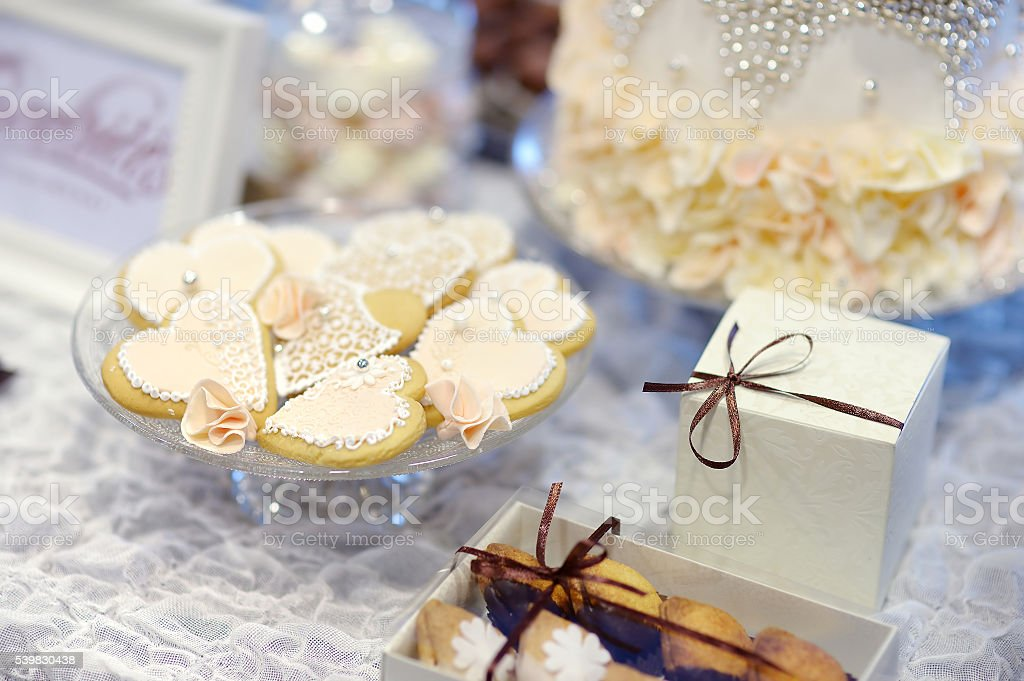 Cookies decorated with flowers and pearls stock photo
