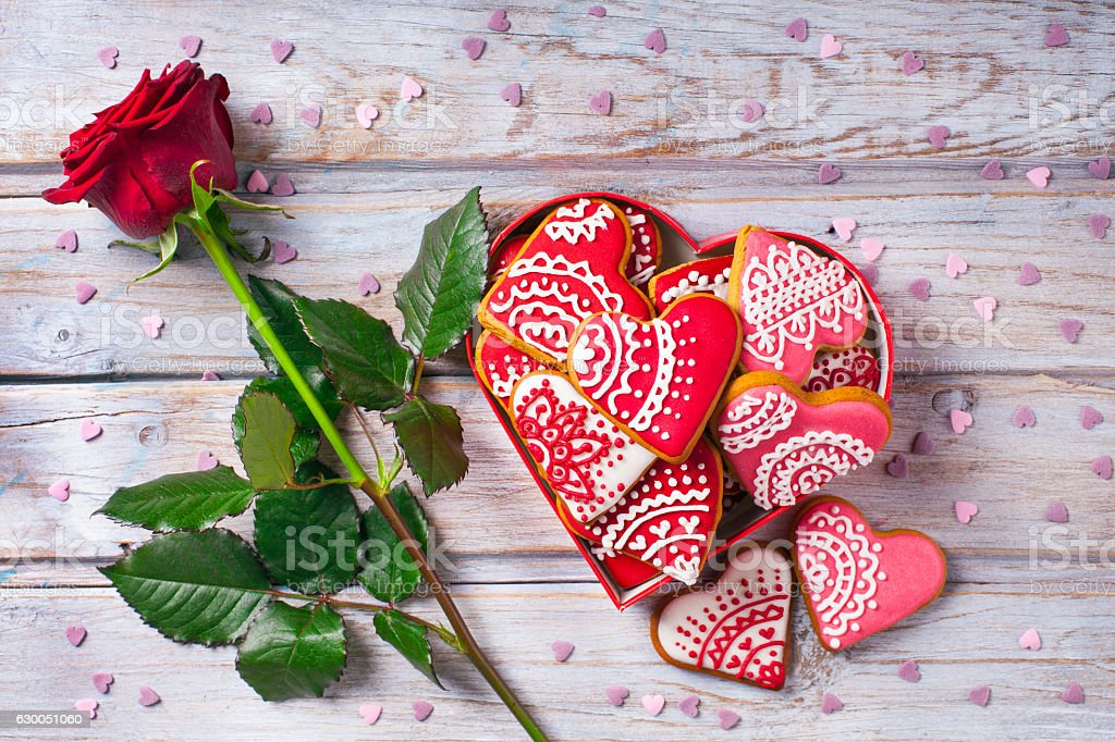 Cookies hearts and rose on old wood desk stock photo