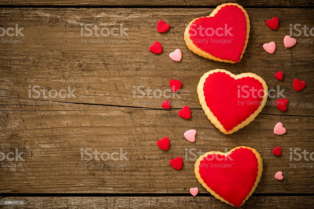 Cookies hearts on old wood background stock photo