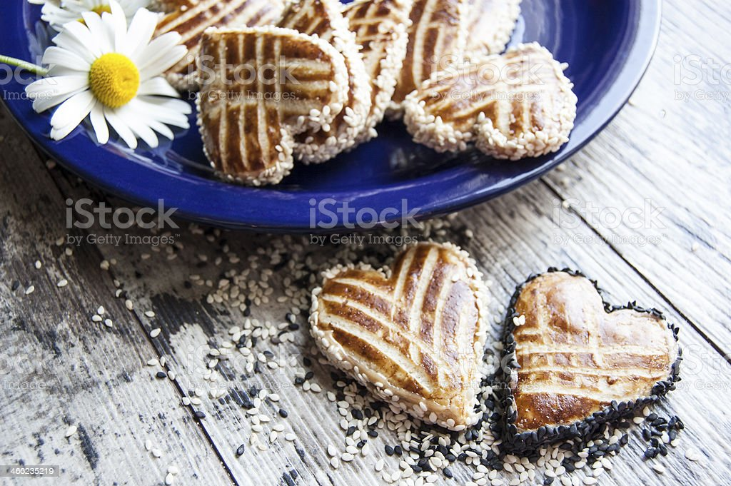 Cookies in shape of heart on blue plate. Close-up royalty-free stock photo