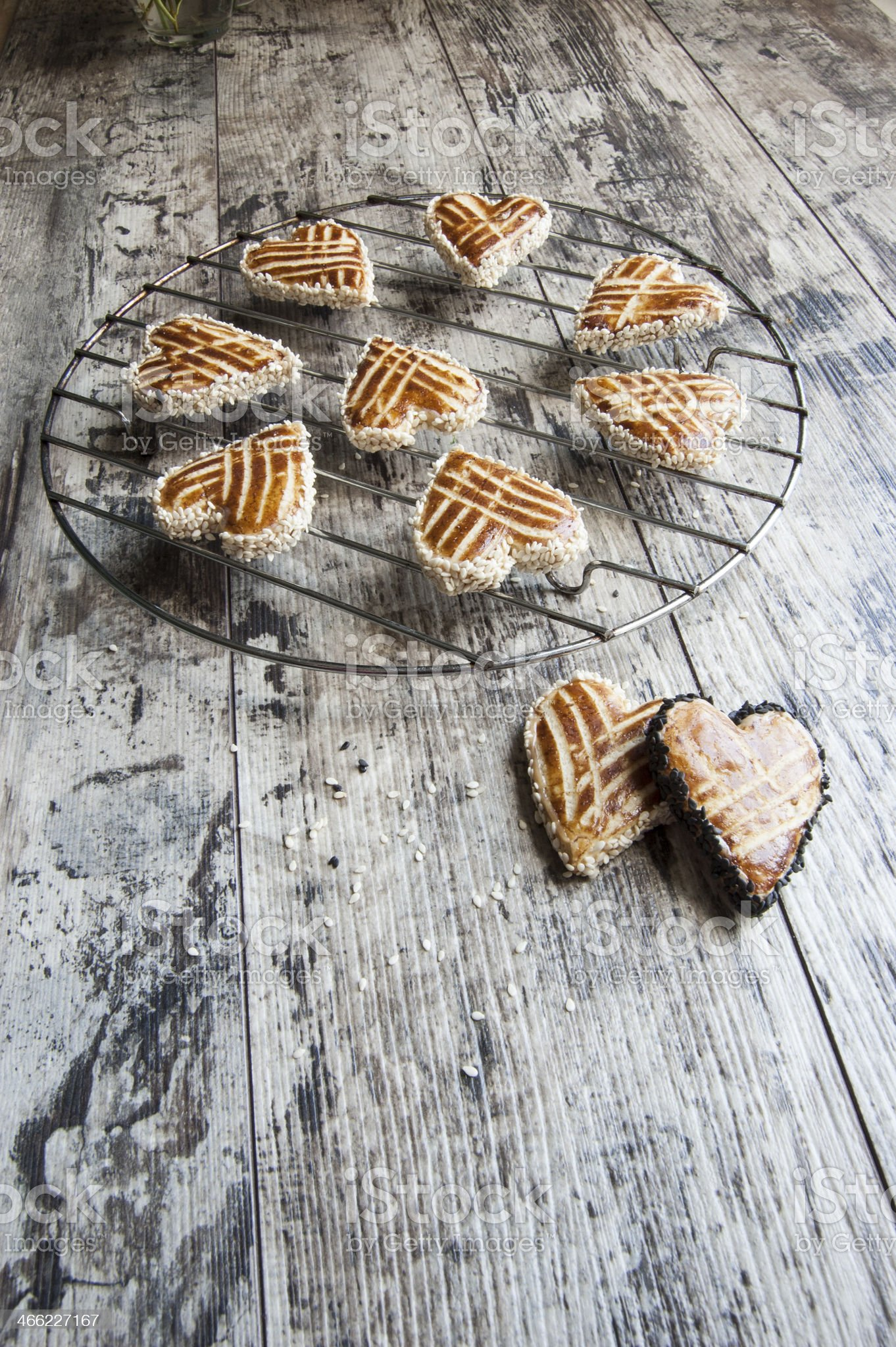 Cookies in shape of heart on metal grille royalty-free stock photo