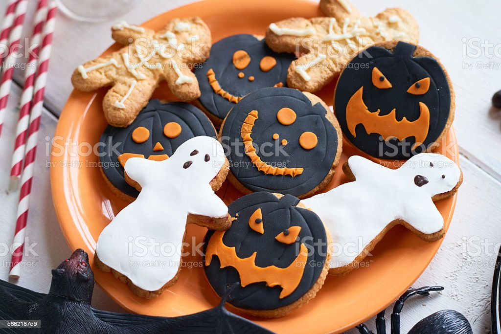 Cookies in shapes of Halloween characters on plate stock photo
