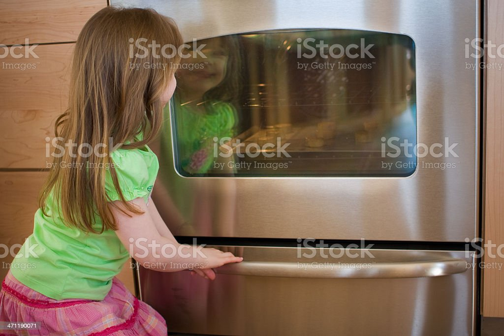 cookies in the oven royalty-free stock photo