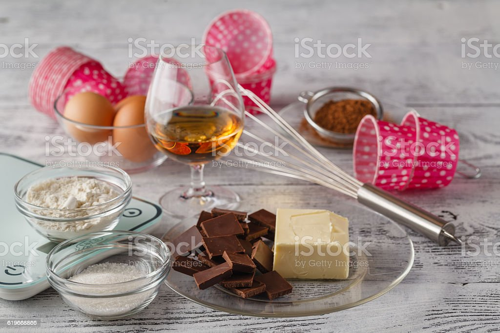 Cookies ingredients (raw egg, brown sugar, apple, butter and flo stock photo