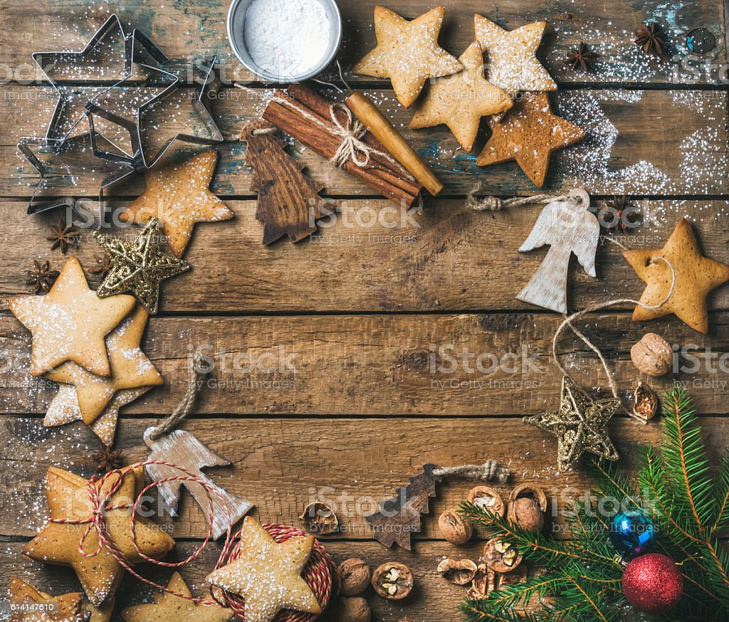 Cookies, nuts, spices, wooden angels and fir branch with balls stock photo