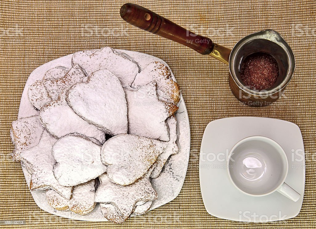 cookies on brown canvas with cup and coffe maker royalty-free stock photo