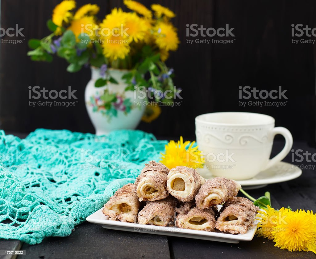 Cookies rolls with rhubarb and cinnamon on a dark background stock photo