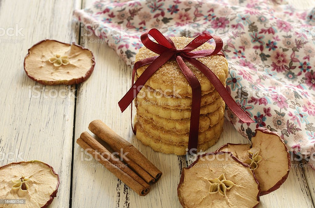 Cookies tied up with ribbon and bow on wooden table royalty-free stock photo