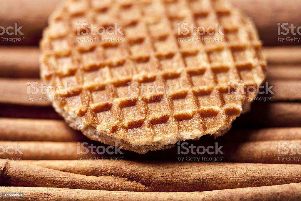 Cookies, waffles with treacle on cinnamon sticks herbs, Dutch 'stroopwafels' stock photo
