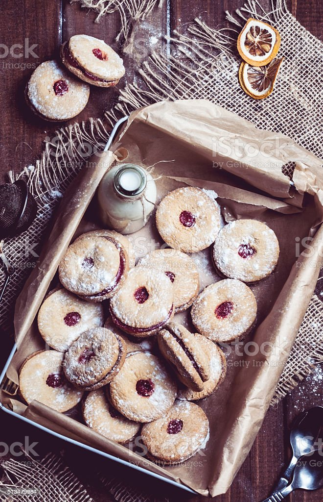cookies with cherry filling in the box stock photo