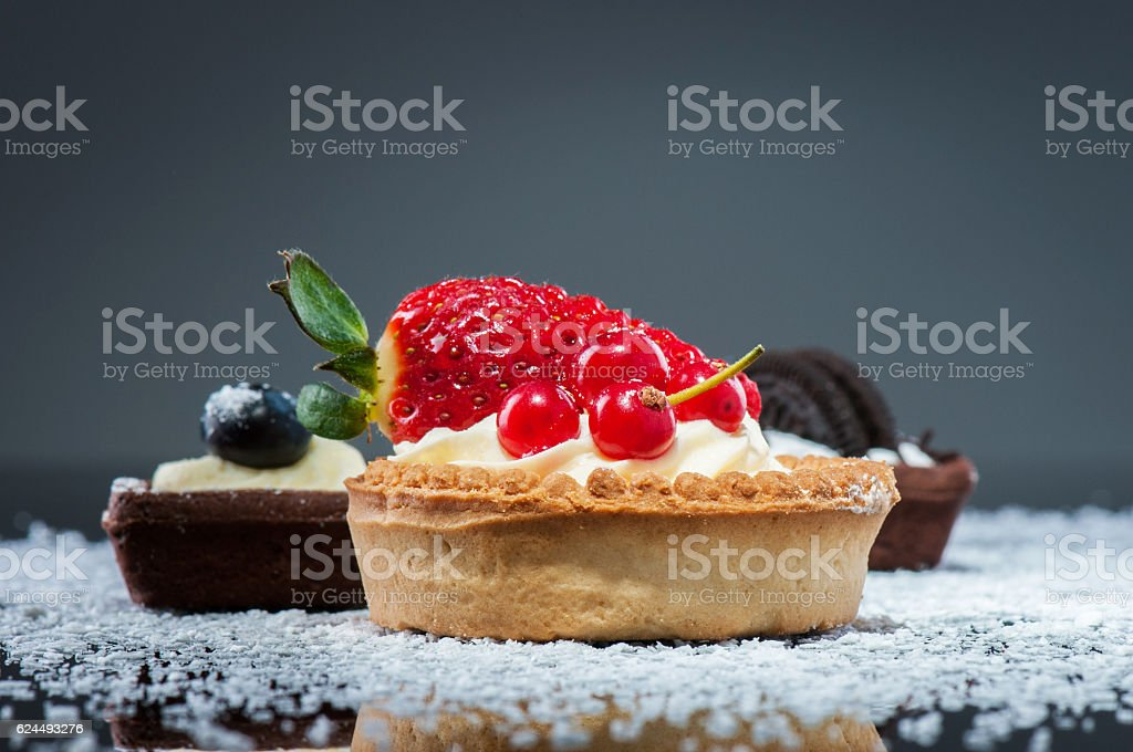Cookies with vanilla cream and red currants stock photo