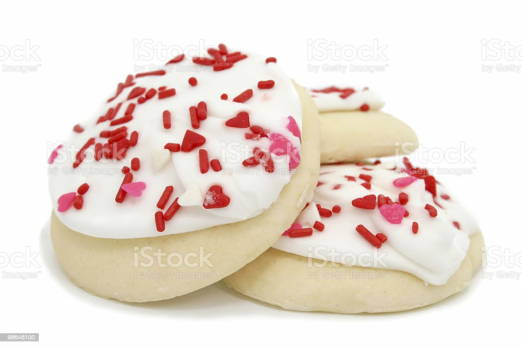 Cookies with White Icing and Heart Sprinkles stock photo