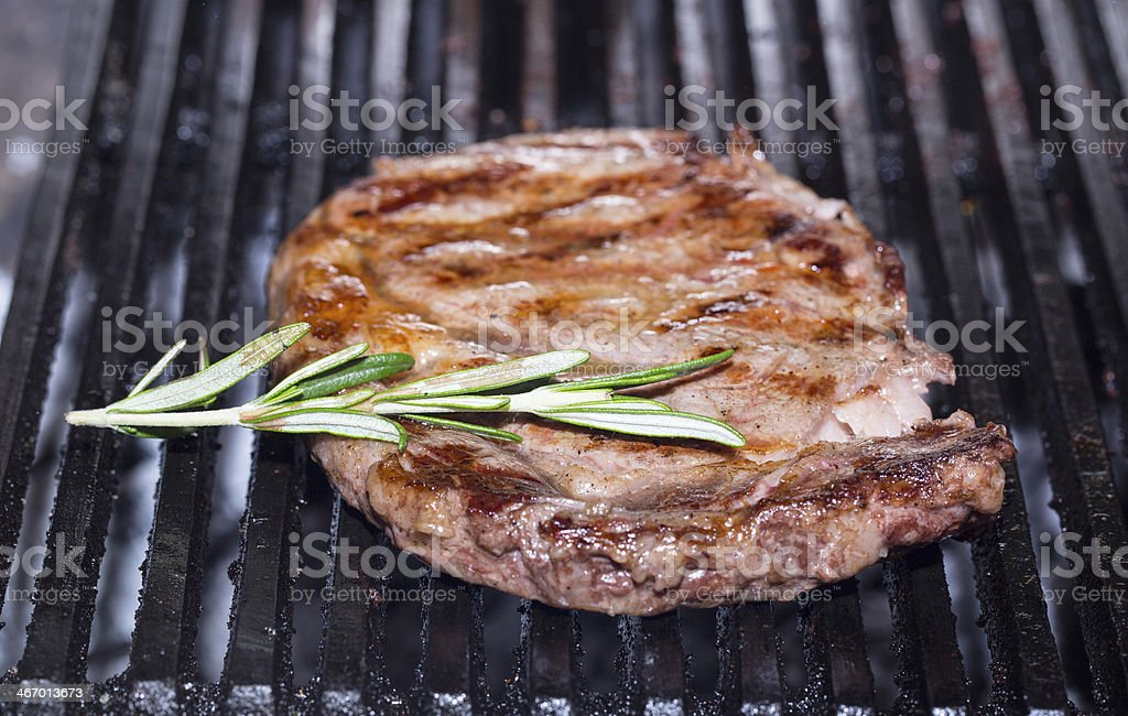 cooking a steak on the grill royalty-free stock photo