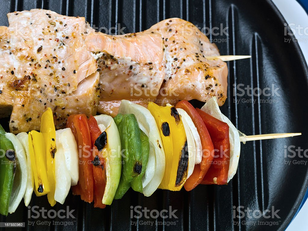 cooking a wild salmon brochette royalty-free stock photo