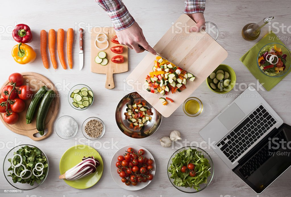 Cooking at home with online recipes stock photo