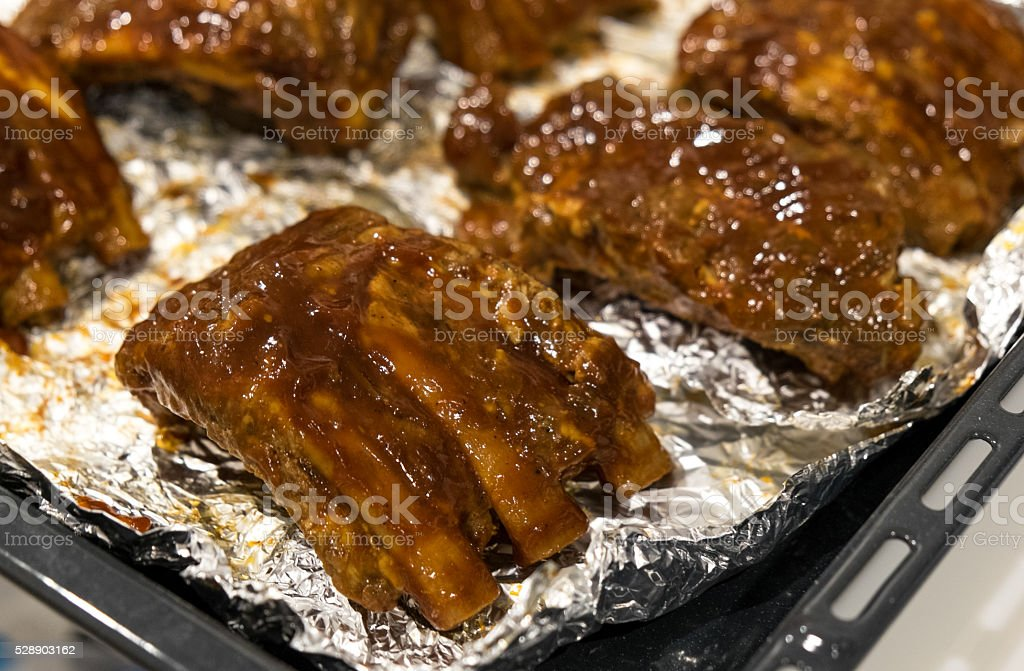 Cooking barbecue pork ribs stock photo