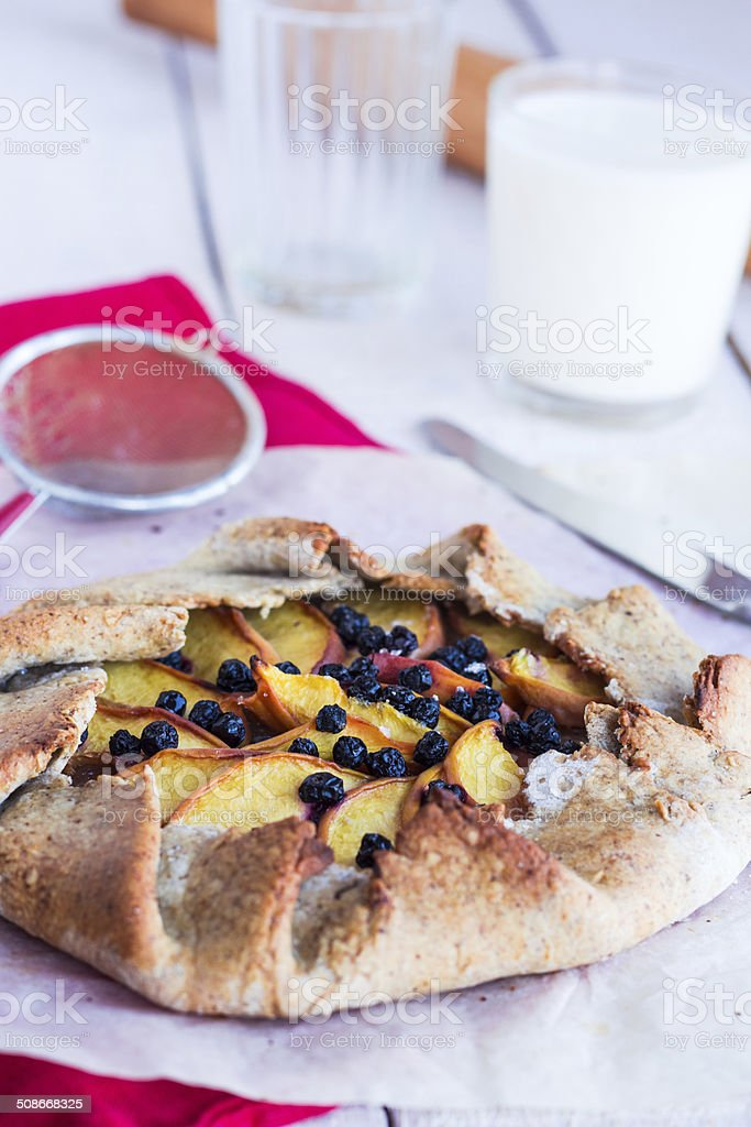 cooking biscuits with peach and blueberry stock photo